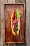 Oktoberfest. German hot dog with grilled sausages, onions and vegetables. French roll with grilled sausages from lamb royalty free stock photo
