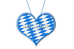 Oktoberfest gingerbread heart. Gingerbread heart with bavarian colors for oktoberfest isolated on white stock illustration