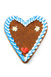Oktoberfest gingerbread heart cake with copy space. On white isolated background stock image