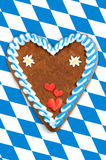 Oktoberfest Gingerbread heart with copy space on bavarian white Stock Photo