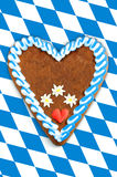 Oktoberfest Gingerbread heart with copy space on bavarian white Royalty Free Stock Photo