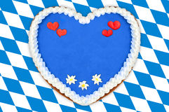 Oktoberfest Gingerbread heart with copy space on bavarian white Royalty Free Stock Image