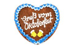 Oktoberfest Gingerbread heart with german words greetings from o. Ktoberfest on white isolated background royalty free stock images