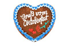 Oktoberfest Gingerbread heart with german words greetings from o. Ktoberfest on white isolated background royalty free stock photography