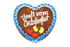Oktoberfest Gingerbread heart with german words greetings from o. Ktoberfest on white isolated background royalty free stock photo