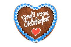 Oktoberfest Gingerbread heart with german words greetings from o. Ktoberfest on white isolated background stock images