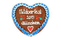 Oktoberfest 2019 Gingerbread heart with white isolated background. October festival is a seasonal beer event in Munich Germany. Traditional heart cakes stock photo