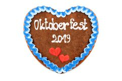 Oktoberfest 2019 Gingerbread heart with white isolated background. October festival is a seasonal beer event in Munich Germany. Traditional heart cakes royalty free stock image