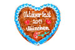 Oktoberfest 2019 Gingerbread heart with white isolated background. October festival is a seasonal beer event in Munich Germany. Traditional heart cakes stock photography