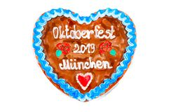 Oktoberfest 2019 Gingerbread heart with white isolated background. Painted Oktoberfest 2019 Gingerbread heart with white isolated background. October festival is royalty free stock photo