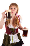 Oktoberfest girl blows with beer foam Stock Photo