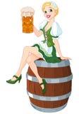 Oktoberfest Girl. German girl sits on the keg and holds mug Stock Photos