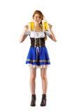 Oktoberfest girl holding jugs of beer Stock Photo