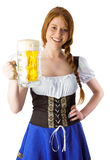 Oktoberfest girl smiling at camera holding beer Royalty Free Stock Image