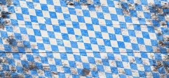 Oktoberfest-Hintergrund mit blauem und weißem Rautenmuster Lizenzfreie Stockbilder