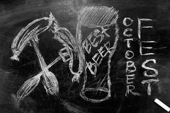 Oktoberfest is a picture of a glass of beer an inscription in chalk on a blackboard stock photo