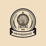 Oktoberfest label. Beer festival sign with hand sketched wooden barrel. Vector vintage brewery badge. Wiesn symbol.  Royalty Free Stock Photos