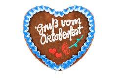 Oktoberfest-Lebkuchenherz mit Deutschem fasst Grüße von O ab lizenzfreie stockfotografie