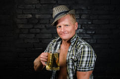 Oktoberfest. Man at the bar. Attractive adult man with a beer in the pub stock photography