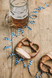 Oktoberfest: Masskrug of beer, Pretzels and bavarian streamer Royalty Free Stock Image