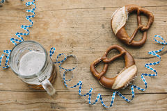 Oktoberfest: Masskrug of beer, Pretzels and bavarian streamer Royalty Free Stock Photography