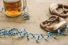 Oktoberfest: Masskrug of beer, Pretzels and bavarian streamer Stock Image