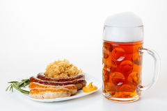 Oktoberfest menu, beer mug, a plate of sausages and sauerkraut Stock Photography