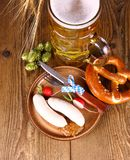 Oktoberfest menu - beer, white sausage, pretzel, radish Royalty Free Stock Photography