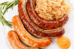 Oktoberfest menu, plate of sausages and sauerkraut Royalty Free Stock Image