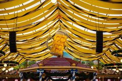 Oktoberfest, Munich, Germany, yellow tent roof background. Oktoberfest, Munich, Germany, tent interior, yellow roof background royalty free stock images