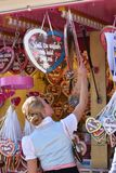 Oktoberfest Munich. Lady buying gingerbread hearts at Oktoberfest in Munich, Germany Stock Photography