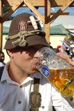 Oktoberfest Munich. A man drinking one liter Mass beer at the Oktoberfest Munich www.oktoberfest.de/en Royalty Free Stock Image