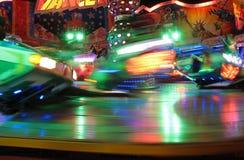 Oktoberfest nightlife. Colorful blurred carousel at night - funfair at Oktoberfest, Munich, Germany Stock Photo