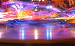 Oktoberfest nightlife fun. (Abstract) Colorful carousel at night - funfair at Oktoberfest, Munich, Germany Stock Images