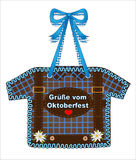 Oktoberfest, October party gingerbread Shirt from gingerbread with squares in blue, heart and edelweiss, October party card Greeti Royalty Free Stock Photo