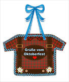 Oktoberfest, October party gingerbread Shirt from gingerbread with squares in red, heart and edelweiss, October party card Greetin Stock Image