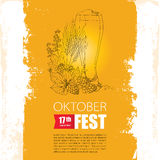 Oktoberfest poster with beer glass, Hops and barley on the grunge textured background. Stock Photo