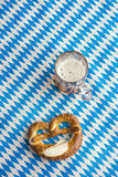 Oktoberfest: Pretzel and Beer on bavarian tablecloth Royalty Free Stock Photo