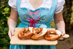Oktoberfest pretzel in woman hands Stock Photos