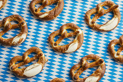 Oktoberfest: Pretzels on bavarian tablecloth Royalty Free Stock Photography