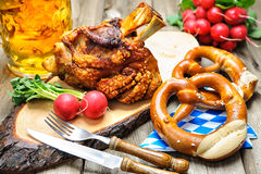Oktoberfest. Roasted pork knuckle with pretzels and beer. Oktoberfest royalty free stock images