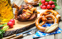 Oktoberfest. Roasted pork knuckle with pretzels and beer. Oktoberfest stock photos
