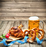 Oktoberfest. Roasted pork knuckle with pretzels and beer. Oktoberfest stock image