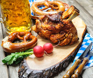 Oktoberfest. Roasted pork knuckle with pretzels and beer. Oktoberfest stock images