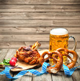 Oktoberfest. Roasted pork knuckle with pretzels and beer. Oktoberfest stock photography