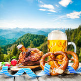 Oktoberfest. Roasted pork knuckle with pretzels and beer. Oktoberfest german festival background royalty free stock images