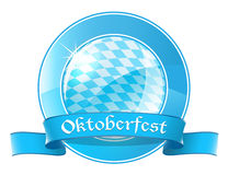 Oktoberfest round banner with ribbon Stock Image