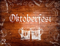 Oktoberfest sign, beer mugs, chalk drawings, wooden background Stock Photo