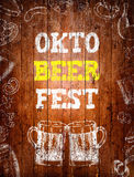 Oktoberfest sign, two beer mugs, chalk drawings, wooden backgrou Stock Photos