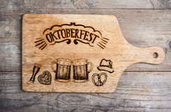 Oktoberfest sign with various hand drawn symbols, cutting board Royalty Free Stock Photos
